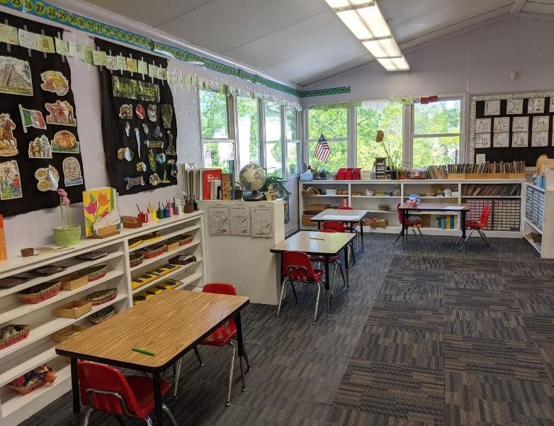 Primary classroom with an array of sensory, math, science, and language jobs on display.