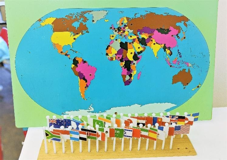 Introducing geography at a young age, students learn about flags and its corresponding countries while engaging in a fun activity.