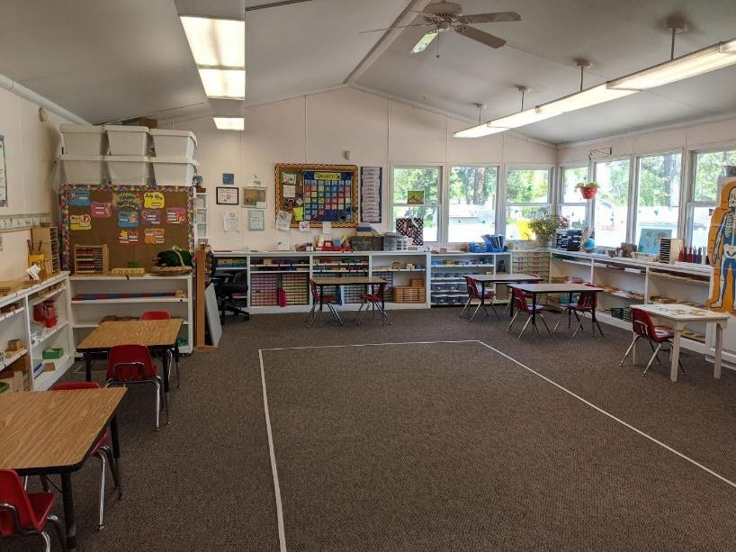 Primary classroom with large space for group/circle time.